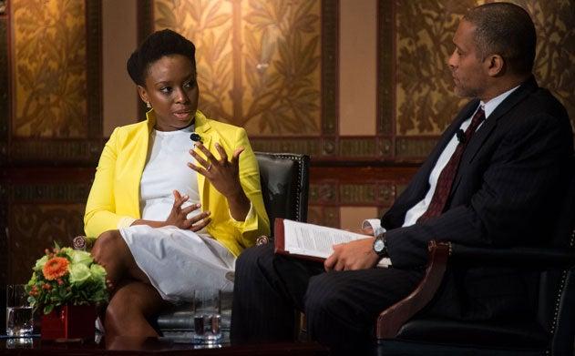 Chimamanda Ngozi Adichie and Scott Taylor talk on stage in Gaston Hall