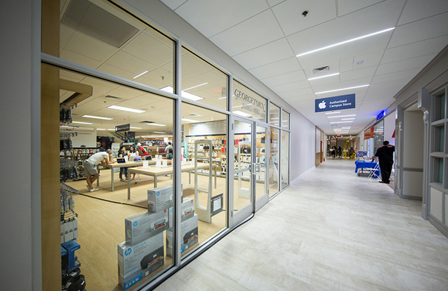 Salespeople work in the new section of the Apple Authorized Campus Store located in the Leavey Center