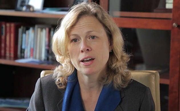 Vicki Arroyo talks in her office