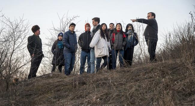 Rev. Patrick Desbois talks with his students while visiting Moldova as part of his mission to discover unmarked mass graves.