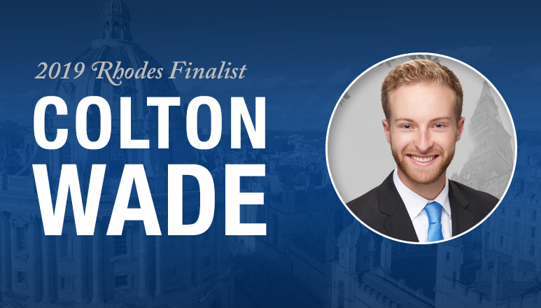 Blue graphic featuring Colton Wade, 2019 Rhodes Scholarship Finalist