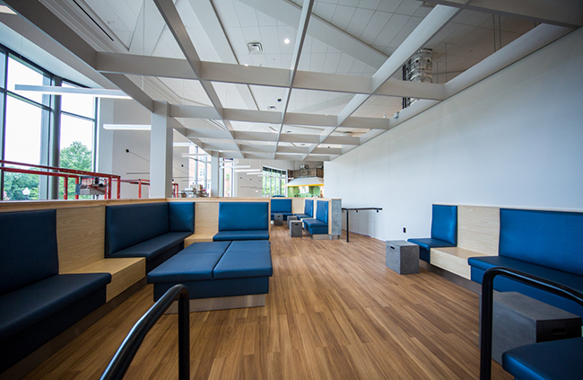 newly renovated dining space features sleek seating with blue fabric and light wood