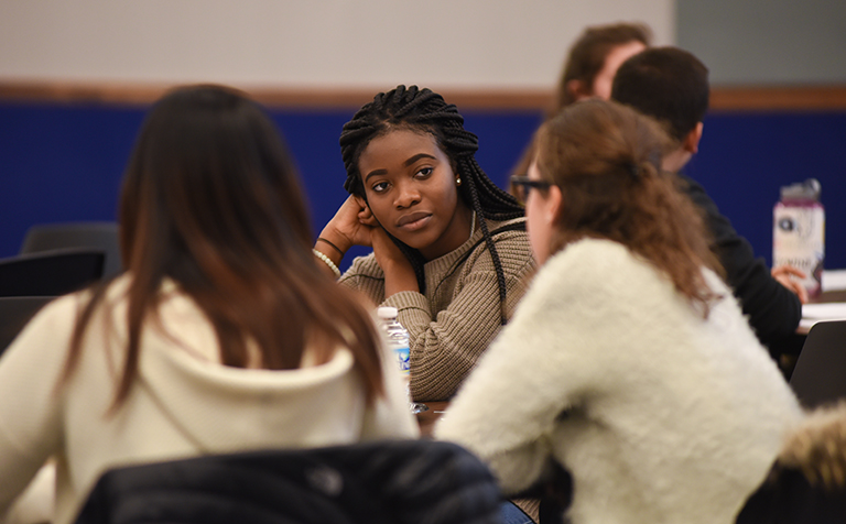 Danielle Maduka sitting and talking with classmates in dialogue session