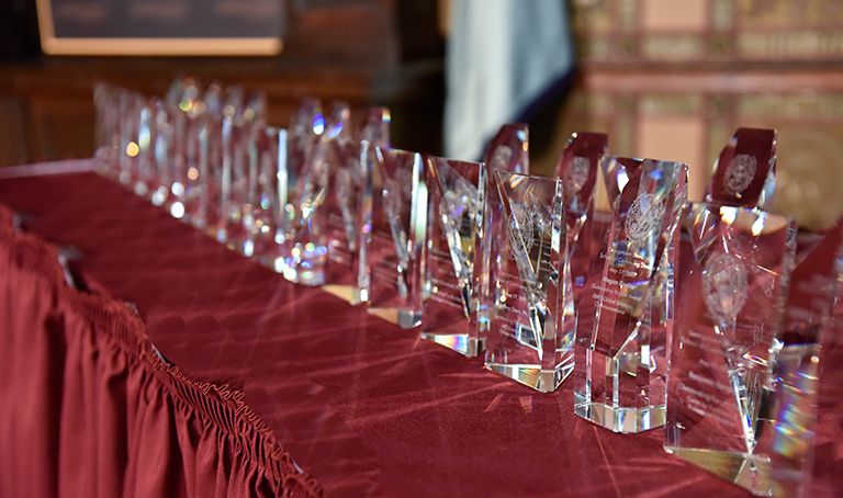 awards for faculty and staff sit on a table