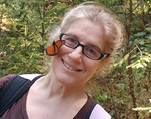 Leslie Ries with butterfly on her face