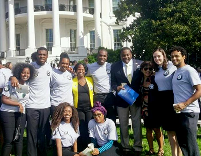 Nekeisha Neal Jones poses in front of the White House with Public Allies