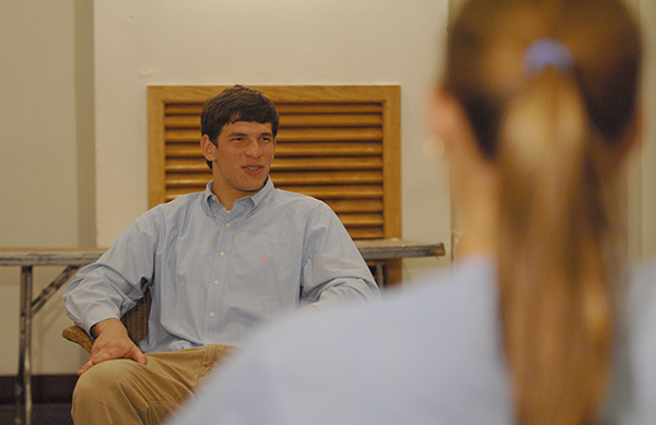 David Fajgenbaum is seated during a support group meeting