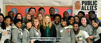 Chelsea Clinton poses with a group of Public Allies during a service event