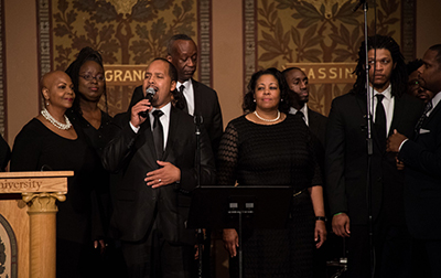 A choir sings in Gaston Hall during the ceremony