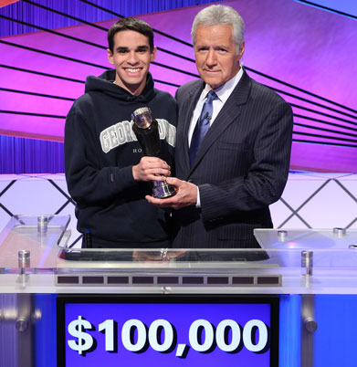 Jim Coury holds trophy with Alex Trebek on set of Jeopardy!