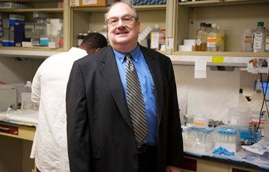 Dr. Eliot Rosen smiles in a lab.