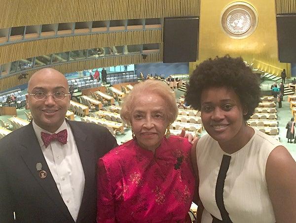 GU 272 descendants Jeremy Alexander, Onita Estes-Hicks and Jada Hawkins in front of the U.N. General Assembly