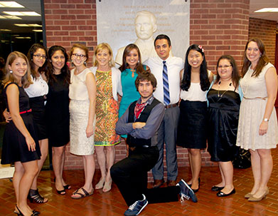 Jane Genster, fifth from left, poses with Georgetown student mentors of Cristo Rey and KIPP students participating in the 2013 Summer Immersion program.
