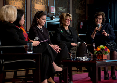 Melanne Verveer, Cherie Blair, Anne Finucane, Mari Pangestu, and Ofra Strauss on Gaston Hall's stage.