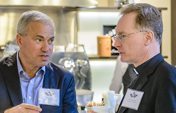 Dr. Jesse Goodman and Kevin FitzGerald, S.J. talk during the workshop