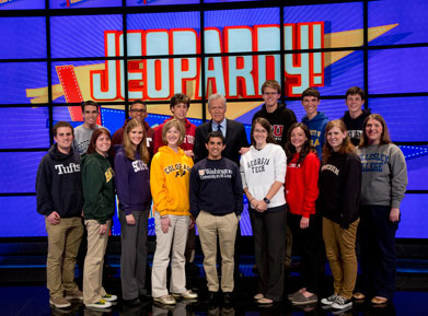 Jim Coury with Alex Trebek and other contestants on the set of Jeopardy!