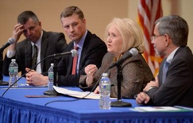 Melanne Verveer speaks as two other panelists look on.