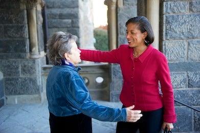 SFS Dean Carol Lancaster greets U.S. National Security Advisor Susan Rice near Healy Hall.