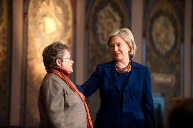 Dean Lancaster with Hillary Clinton on Gaston Hall's stage.