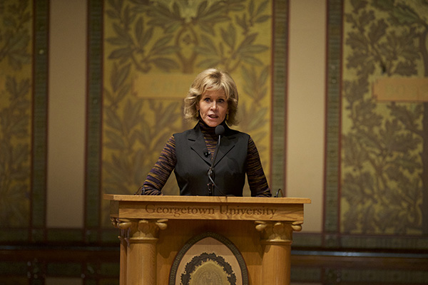 Jane Fonda at podium with Georgetown seal behind her