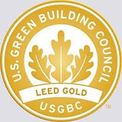 """A photo of the LEED Gold Seal with the words """"U.S. Green Building Council"""" encircling the border."""