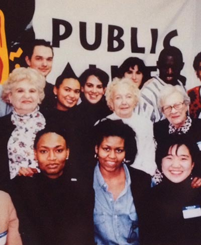 First Lady Michelle Obama is shown in an old photo with members of Public Allies Chicago
