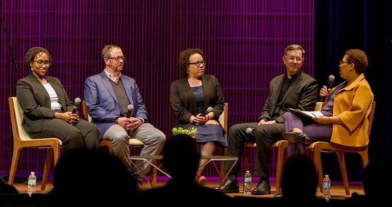 Marcia Chatelain, Kirt Von Daacke, Marisa Fuentes, David Collins listen as Michel Martin asks them a question while holding a microphone.