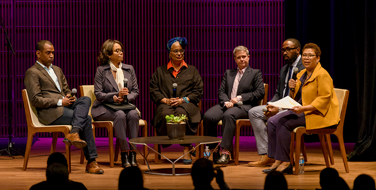 Rodney Leon, Gayle Jessup White, Melisánde Short-Colomb, Sharon Leon and Elgin Cleckley listen on stage while seated as Michel Martin talks to the audience.