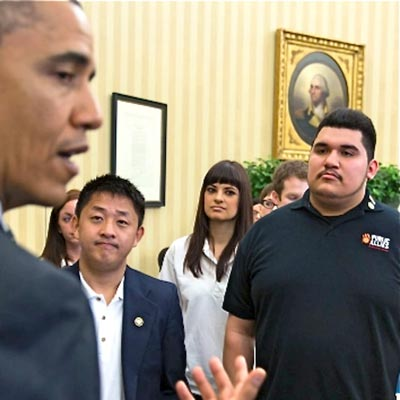 Public Allies and Americorps members listen to President Obama as he talks during their visit to the White House