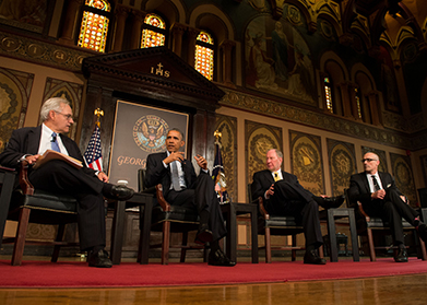E.J. Dionne moderates a panel in Gaston Hall that includes President Obama, Harvard professor Robert Putnam and Arthur Brooks, president of the American Enterprise Institute.