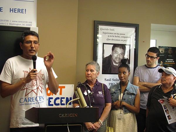 Abel Núñez speaks during a CARECEN Open House.
