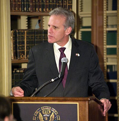 Former Israeli Ambassador to the United States Michael Oren addresses an audience from a podium.