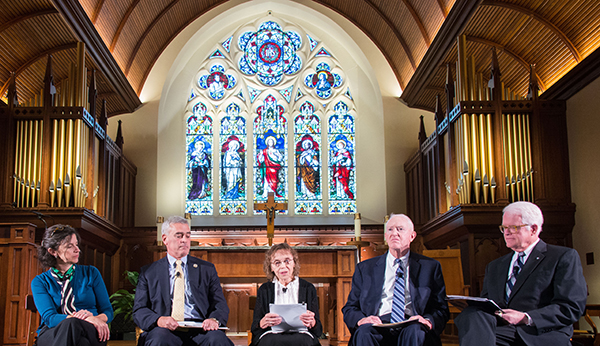 Helen Alvare, Tony Lauinger, Sister Mary Louise Wessell, and Rep. Brad Wenstrup (Ohio-R) sit as a panel in Dahlgren Chapel with stained glass in the background.
