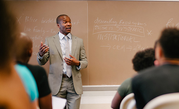 Professor Robert Patterson stands in front of his class teaching