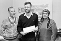 Ebrahim Rasool stands for picture with parents.