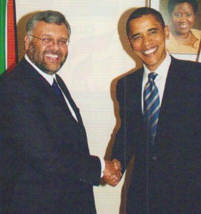 Ebrahim Rasool shakes hand with then Senator Barack Obama