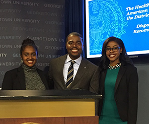 Christopher King, an assistant professor at the university's School of Nursing & Health Studies (NHS) poses for a photo with two student report contributors, Stefanie Kurgatt (NHS'17) and Taylor Brown (NHS'17).