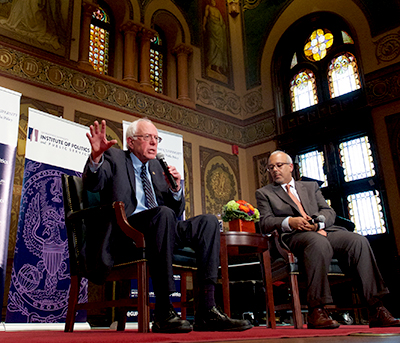 Senator Bernie Sanders sits onstage in Gaston Hall for a discussion with Mo Elleithee.