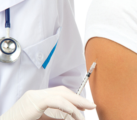 Physcian gives patient a shot in the arm