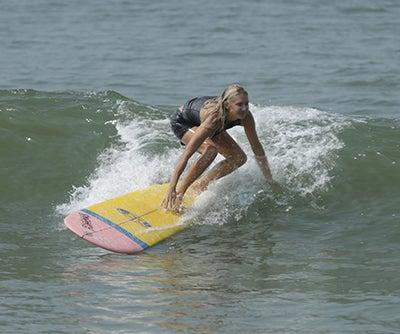 Emi Koch surfing in the ocean