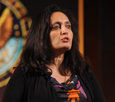 Sonal Shah speaks in front of the Georgetown University seal