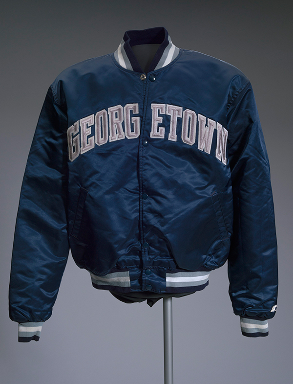 An athletic Starter jacket with Georgetown across it appears on display.