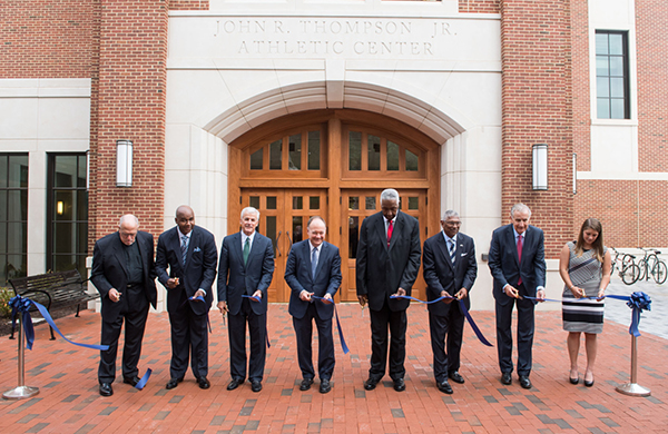 John Thompson, Jr. and President DeGioia and others cut ribbon in front of new athletic building