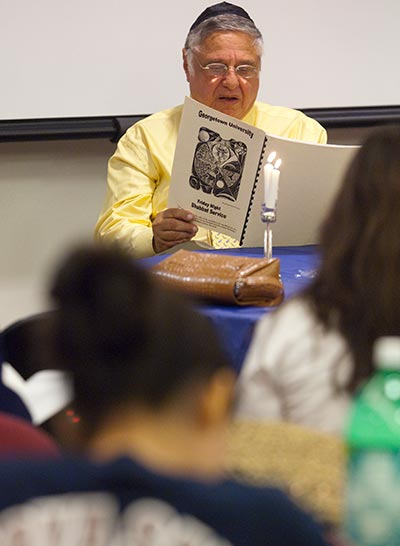 The late Rabbi Harold White, who was the first full-time Jewish chaplain at a U.S. Catholic university and helped develop Georgetown's Jewish civilization program, leads a traditional Shabbat service on campus.