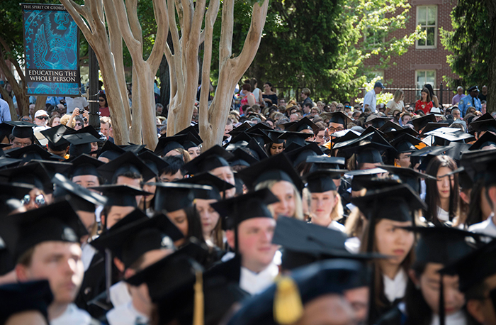 an audience of 2017 graduates shown from the tops of their heads