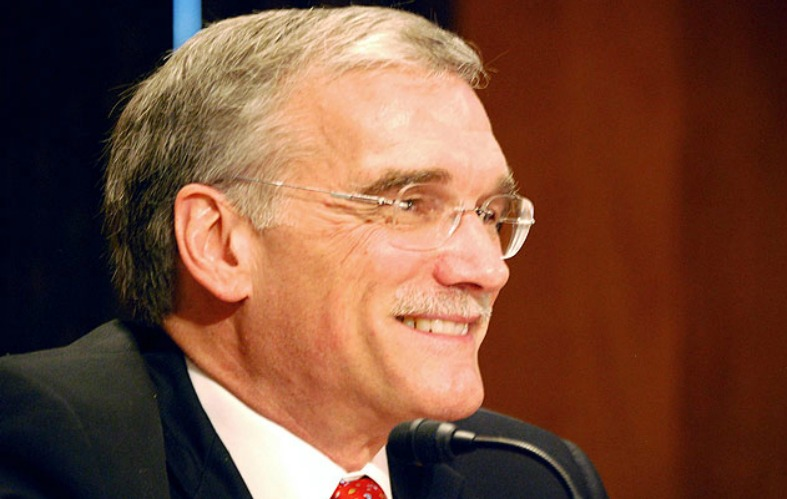 Provost Robert M. Groves smiles in a closeup photo.