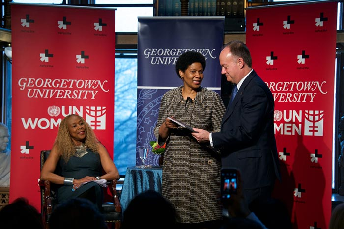 Phumzile Mlambo-Ngcuka talks with Georgetown President John J. DeGioia as Rosemary Kilkenny looks on.