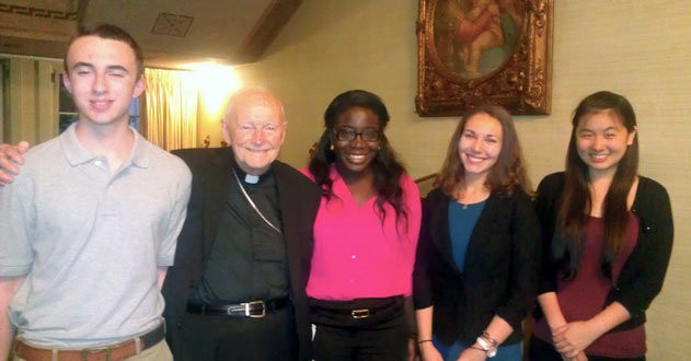 Students stand with Archbishop Emeritus of Washington Theodore Cardinal McCarrick