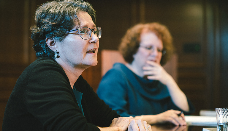 Sherry Linkon seated with Washington Post reporter Amy Goldstein in background