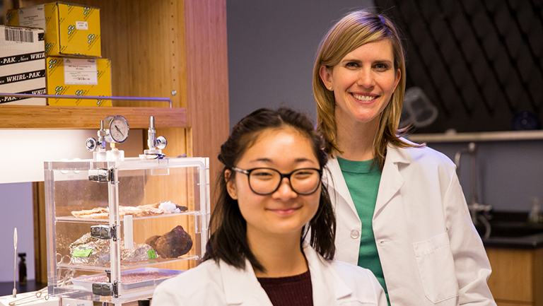 Professor Sarah Stewart Johnson and Angela Bai (C'17) stand together in the lab